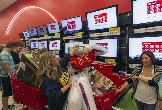 Roxanna Garcia, center, waits to pay for gifts at the Target store in Burbank, Calif., last November.