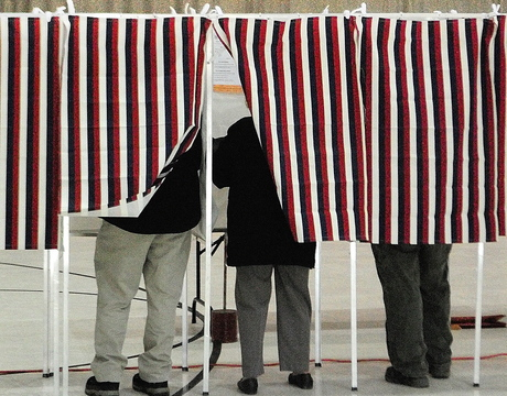 Voters fill in ballots in booths Tuesday at Augusta's Ward 1 polling place in the Augusta Armory.