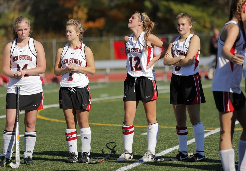 Scarborough field hockey players, left to right, Erin Brady, Mikaela Coombs, Maddy Dobecki, and Rachael Wallace had a hard time watching as they received the runners up trophies after losing the Class A field hockey championship to Skowhegan at Yarmouth High School Saturday, November 2, 2013.