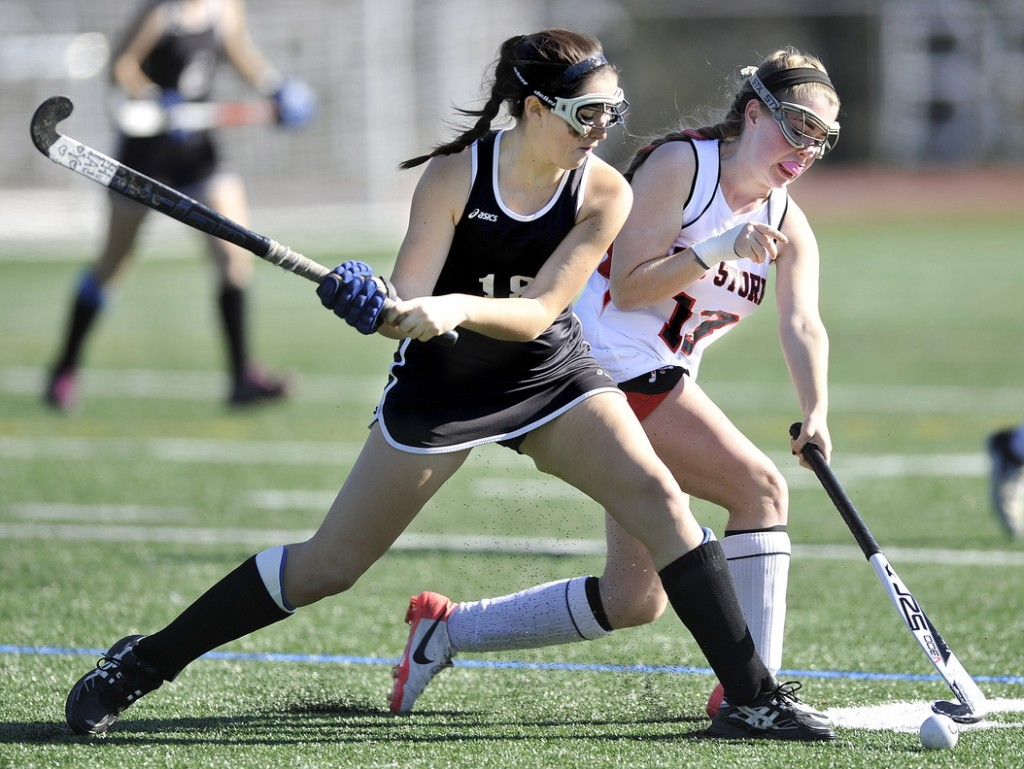 Skowhegan's Haley Thebarge competes with Scarborough's Maggie Carbin for control of the ball in second half action during the Class A field hockey championship at Yarmouth High School Saturday, November 2, 2013.