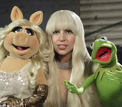 "Lady Gaga appears with Miss Piggy and Kermit the Frog in a promotional photo for ""Lady Gaga & the Muppets' Holiday Spectacular"" airing at 9:30 p.m. Thursday on ABC."