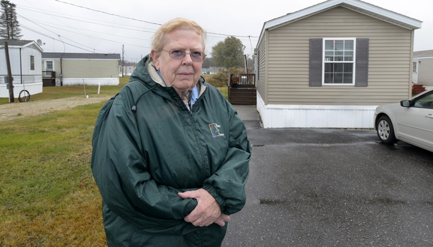 Sharon Brown, standing outside her mobile home in Brunswick, saw her property tax bill increase 12.6 percent this year. She is among about a dozen mobile home owners who have questioned their assessments.