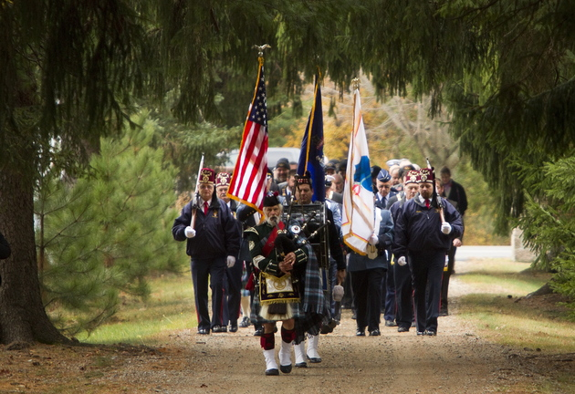 A piper leads the color guard into Pine Grove Cemetery before the second annual Veterans Day observance in West Kennebunk on Sunday.