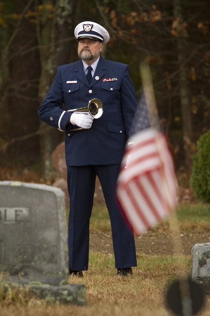 Ensign Harold Jamieson, a Coast Guard bugler, stands by during the second annual Veterans Day observance at Pine Grove Cemetery in West Kennebunk on Sunday.