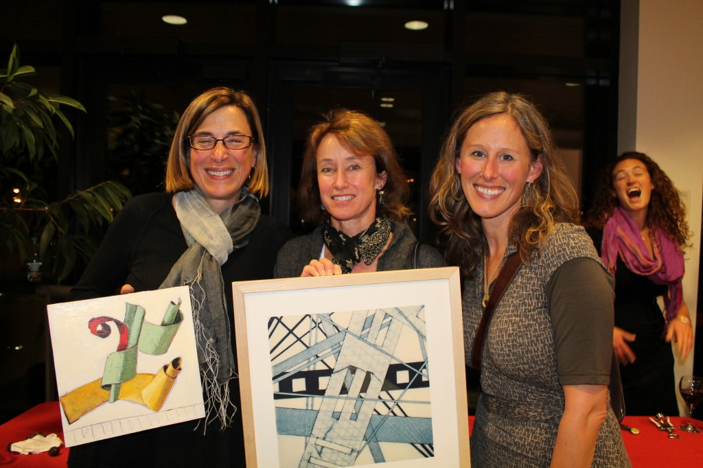 Artists Chris Beneman of Portland, Liz Armstrong of Yarmouth and Dietlind Vander Schaaf of Portland, proudly display their newly acquired original artwork.