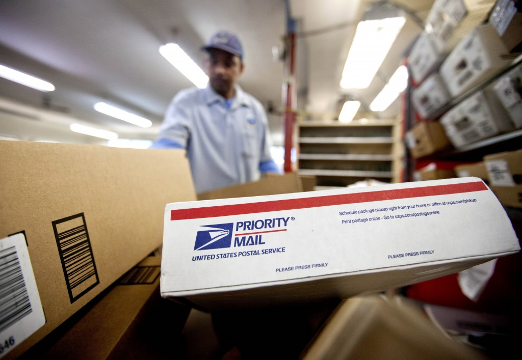 This Feb. 7, 2013 file photo shows packages waiting to be sorted in a Post Office in Atlanta. The U.S. Postal Service said Friday it lost $5 billion over the past year, and postal officials again urged Congress to pass legislation to help the beleaguered agency solve its financial woes.