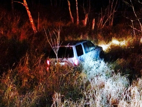 A 2001 Ford Explorer rests in a swamp off Carl Broggi Highway (Route 1 02) about a mile west of Little River Road in Lebanon Monday night. The driver escaped unharmed.