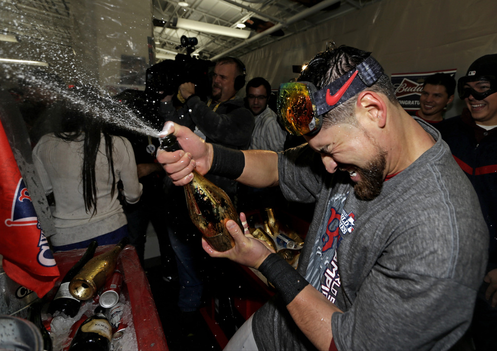 Jacoby Ellsbury, shown celebrating with teammates after the Red Sox won the World Series last week, received a qualifying offer from the team. He is expected to seek a long-term deal worth $20 million or more per year.