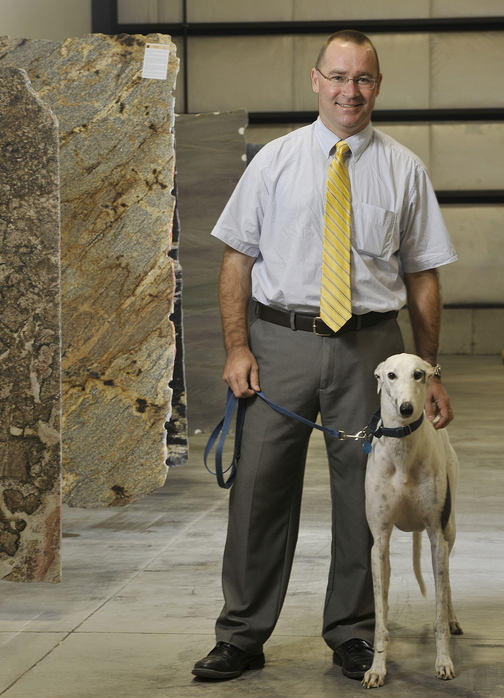 Matt Qualey, shown with his rescue dog Baron, is expanding his granite supply business to the Pine Tree Industrial Park in Portland. Qualey was named Maine Small Business Person of the Year.