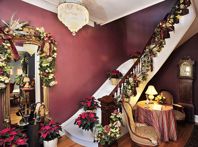 This staircase and hall mirror are the work of Dan Kennedy in the 1876 home that he owns with John Hatcher. Five Victorian-era homes were decked out for Christmas to raise money for Gary's House, a local nonprofit.