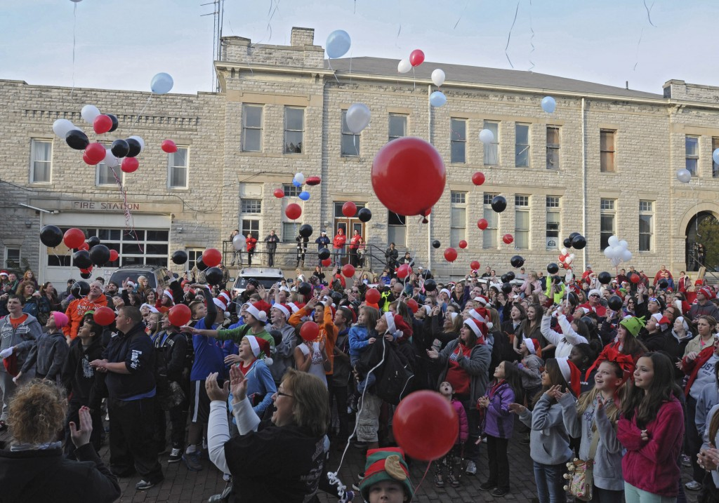 Balloons are released as a large crowd sings Christmas carols outside of Devin Kohlman's home in Port Clinton, Ohio, on Oct. 28.