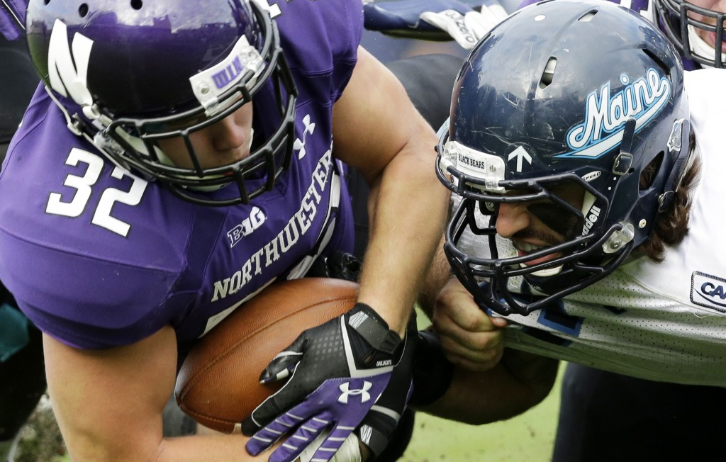 Troy Eastman, right, isn't shy about getting into a foe's face, as Northwestern running back Mike Trumpy can attest.