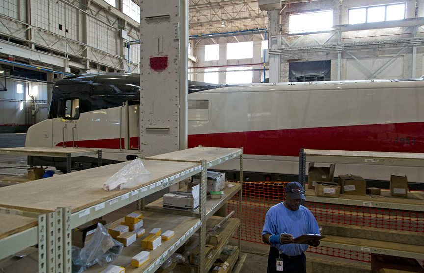 Corey Stacy, an inventory control worker, performs his daily duties last month at the Talgo plant in Milwaukee, where high-speed rail cars now sit dormant.
