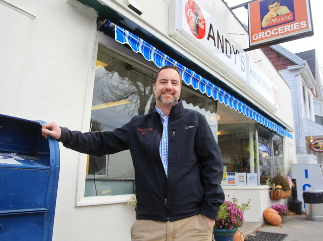Matt Williams stands in front of his Andy's Handy Store in Yarmouth. His purchase of the shop in July triggered the loss of the contract to offer full postal services.
