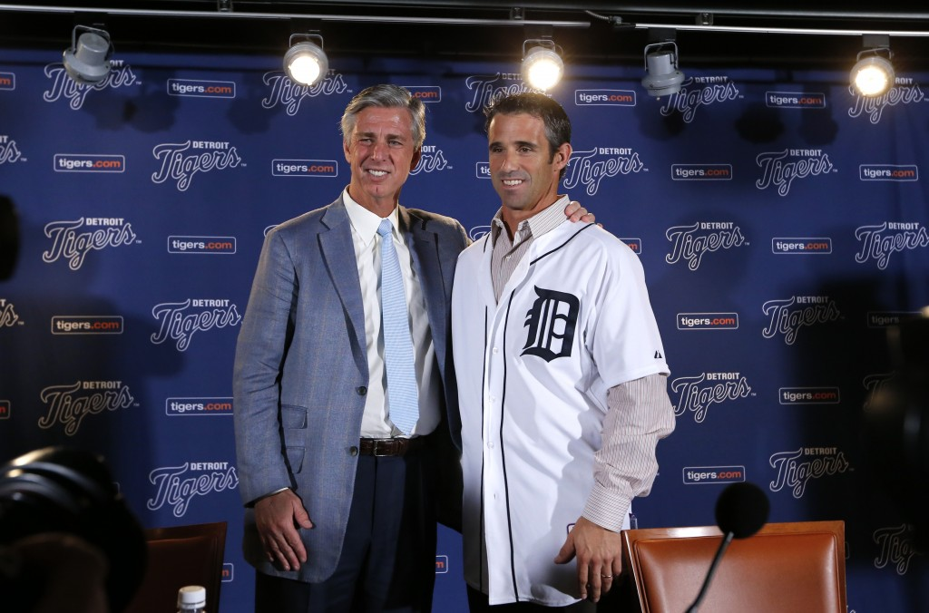 Detroit Tigers general manager David Dombrowski, left, introduces Brad Ausmus as the new Detroit Tigers manager during a news conference in Detroit Sunday, Nov. 3, 2013. Ausmus replaces Jim Leyland who stepped down as manager.