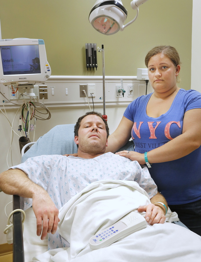 Casey Larcombe, shown at the hospital with his fiancee, Kathryn LePage, says a Toyota Carolla swerved into his family's car, sending it into the median strip on Interstate 295 on Wednesday.