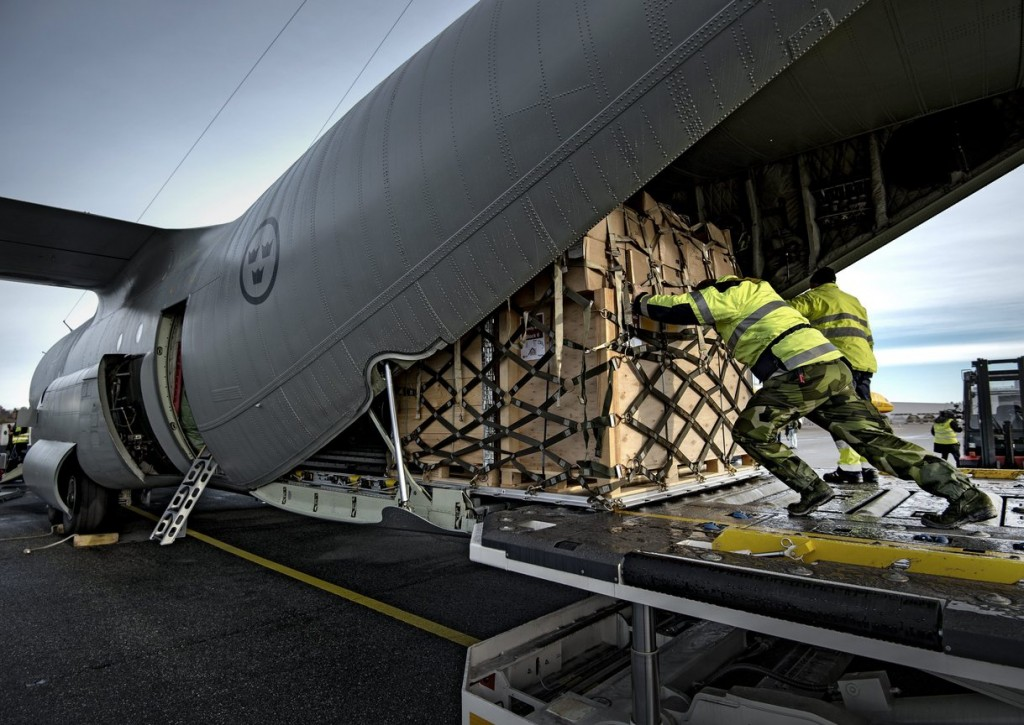 Staff load a Hercules aeroplane with relief equipment at Orebro airport in central Sweden, Monday, Nov. 11, 2013. The Swedish Civil Contingencies Agency, MSB, together with its International Humanitarian Partnership, IHP, partners on Monday sent equipment to support the UN disaster relief work in the Philippines. (AP Photo/TT News Agency, Per Knutsson)