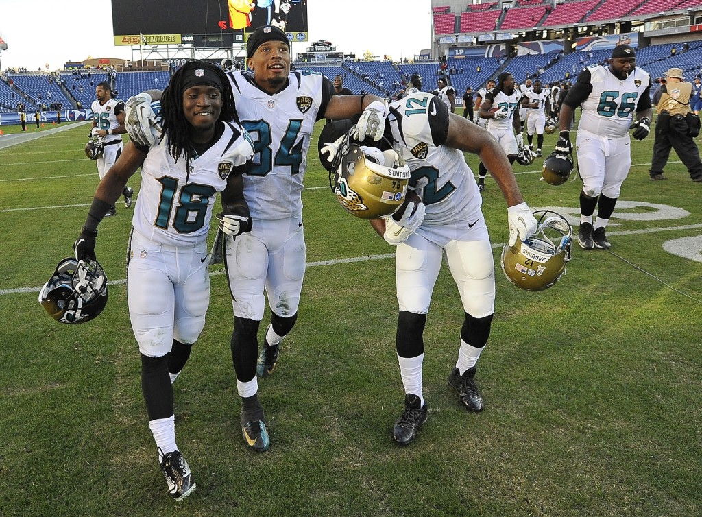 Jacksonville Jaguars players Ace Sanders (18), Cecil Shorts (84) and Mike Brown (12) celebrate as they leave the field after the Jaguars beat the Tennessee Titans 29-27 in an NFL football game on Sunday, Nov. 10, 2013, in Nashville, Tenn.