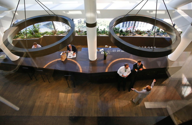 Employees conduct business inside the CBRE Group headquarters that occupy the top two stories of a 26-story building in downtown Los Angeles. There are no assigned desks, and employees can sit wherever they want.