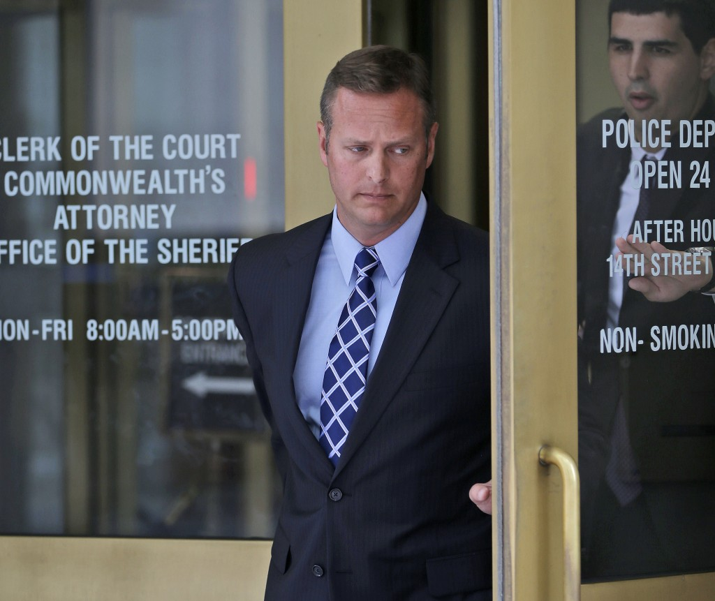 Lt. Col. Jeffrey Krusinski, who led the Air Force's Sexual Assault Prevention and Response unit, leaves the Arlington County, Va. General District Court in this July 18, 2013, photo.