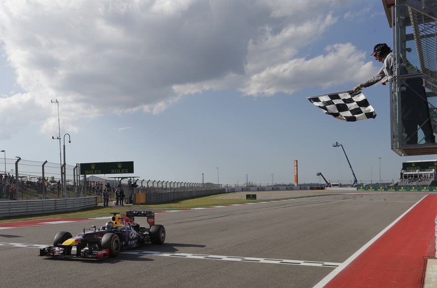 Red Bull driver Sebastian Vettel of Germany crosses the finish line to win the Formula One U.S. Grand Prix auto race at the Circuit of the Americas, Sunday, Nov. 17, 2013, in Austin, Texas.
