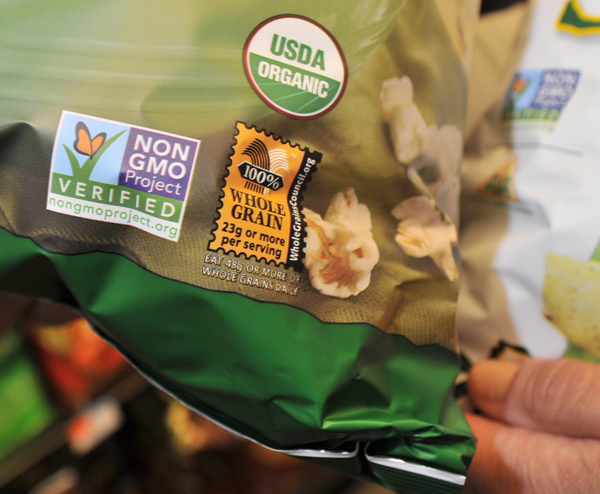 A label on a snack item indicates it as certified organic and not containing any GMOs or genetically modified organisms, at a Portland supermarket, Wednesday, July 24, 2013.