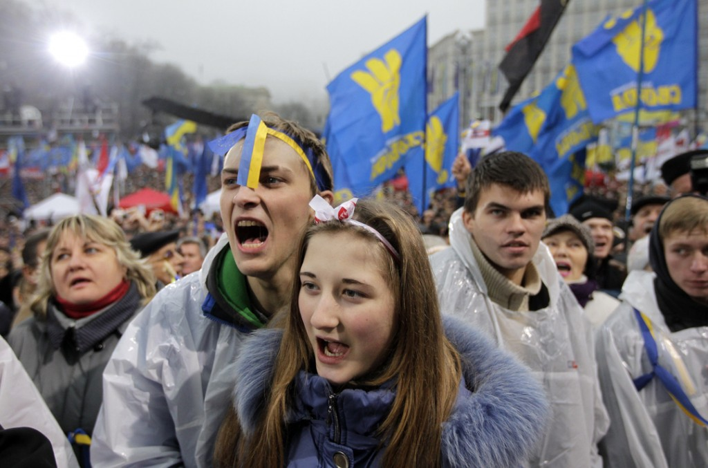 Demonstrators shout slogans during a protest in Kiev, Ukraine, Sunday, Nov. 24, 2013. Tens of thousands of demonstrators marched through central Kiev on Sunday to demand that the Ukrainian government reverse course and sign a landmark agreement with the European Union in defiance of Russia. The protest was the biggest Ukraine has seen since the peaceful 2004 Orange Revolution, which overturned a fraudulent presidential election result and brought a Western-leaning government to power. (AP Photo/Sergei Chuzavkov)