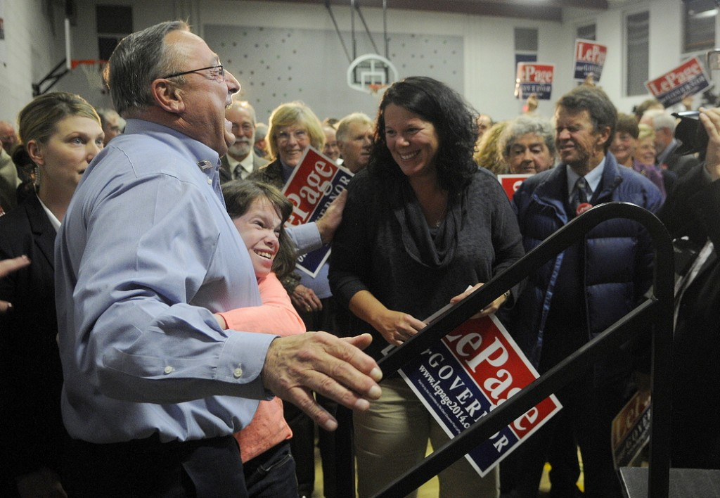 Gov. Paul LePage gets a hug from a child after officially kicking off his re-election campaign Tuesday during a rally in Augusta attended by about 200 supporters.