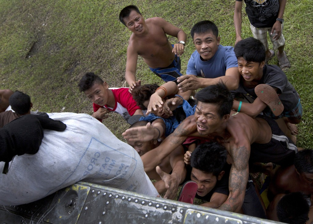Villagers stranded by Typhoon Haiyan scramble for aid from a U.S. Navy Sea Hawk helicopter in the coastal town of Tanawan, central Philippines, on Sunday. Typhoon Haiyan, one of the most powerful storms on record, hit the country's eastern seaboard Nov. 8, leaving a wide swath of destruction.