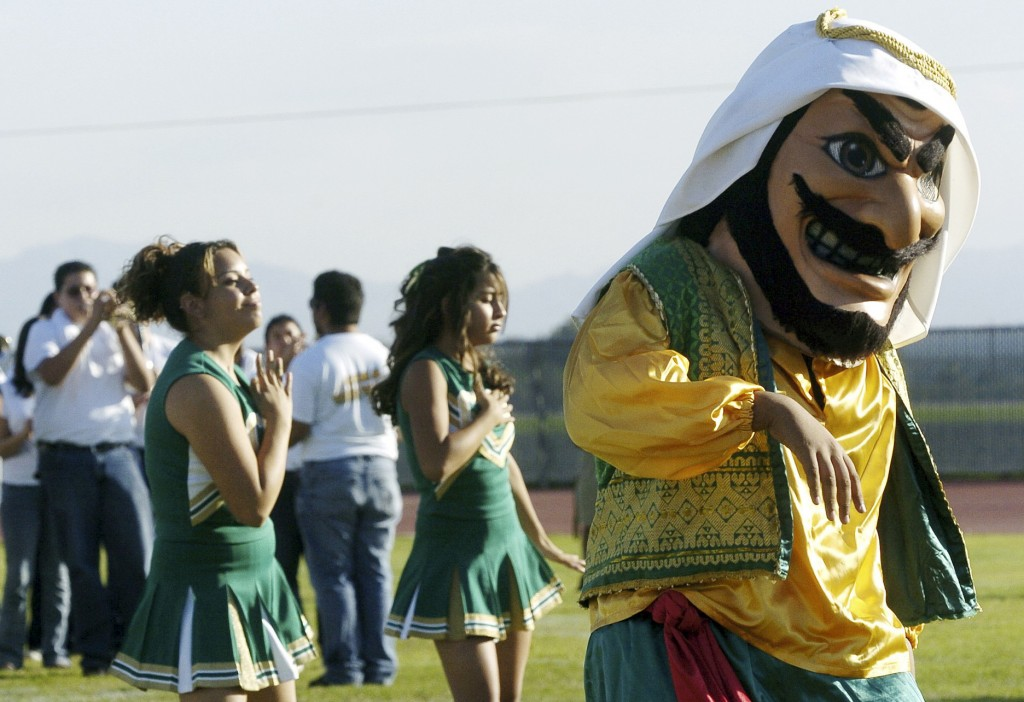 "Coachella Valley High School's mascot, ""Arab,"" dances to the band during a pep rally at the school in Thermal, Calif. School officials in Southern California say the 'Arabs' are here to stay, but the costumed mascot that represents them may be changing."