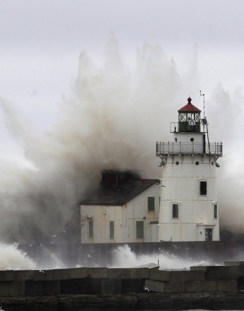 Waves pound a lighthouse on the shores of Lake Erie near Cleveland on Oct. 20, 2012. It is unusual for 20-foot waves, large surges and tropical-force winds to be recorded in the Great Lakes for a coastal tropical storm, but it happened with Superstorm Sandy.