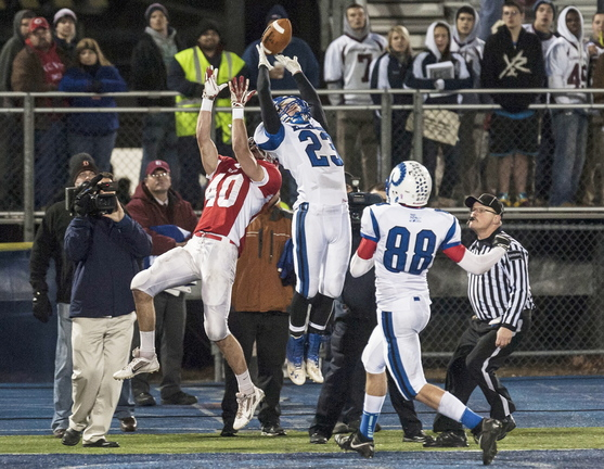 Liam Studley of Kennebunk, 23, breaks up a pass intended for Jonathan Saban of Cony in the first half of their Class B state championship game Friday night. Saban came back to haul in the winning touchdown pass with a minute remaining as Cony emerged with a 30-23 victory at Orono.