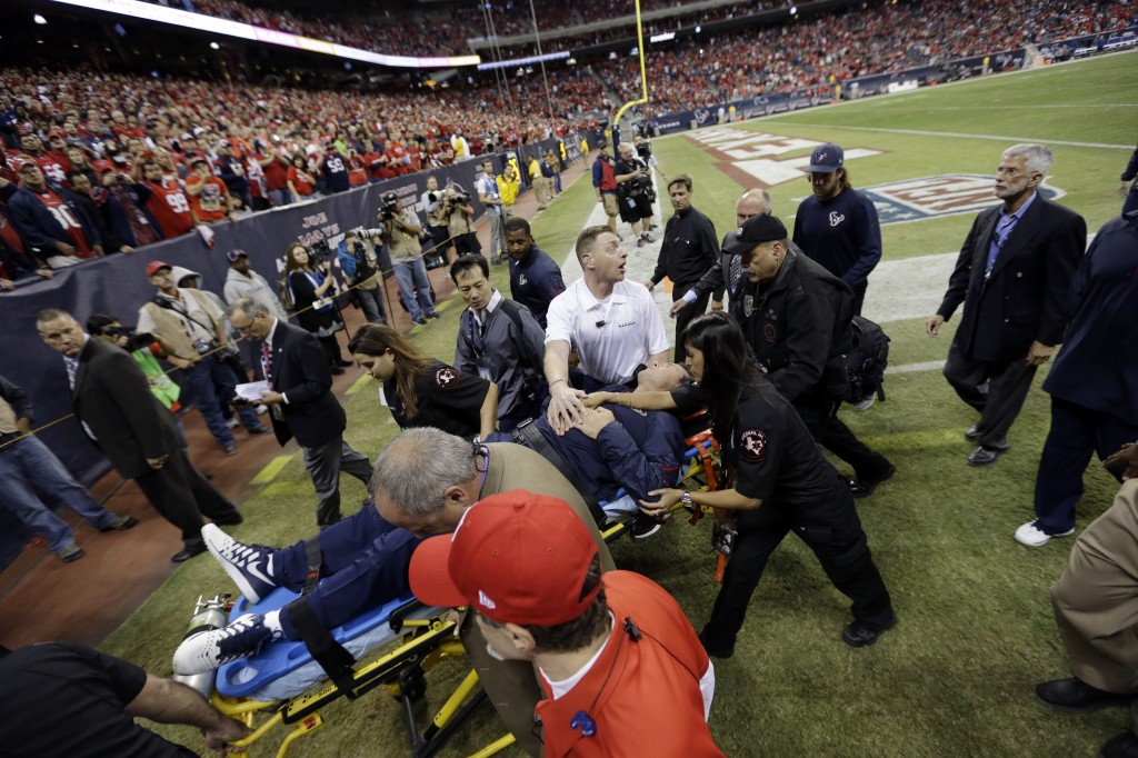 Houston Texans head coach Gary Kubiak is taken off the field on a stretcher during the second quarter of an NFL football game against the Indianapolis Colts, Sunday, in Houston.
