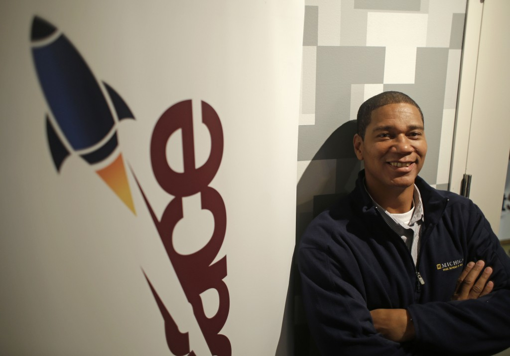 Kenyatta Leal, a former prison inmate, poses outside the office at Rocket Space in San Francisco, where he joins a team of engineers and designers on the same career path, but with drastically different stories of how they got there.