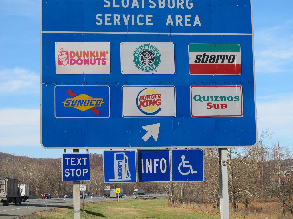 "A new ""text stop"" notification is seen on a sign for a service area on the New York State Thruway in Sloatsburg, N.Y.. A state crackdown on texting while driving includes designating many pull-off areas as text stops."