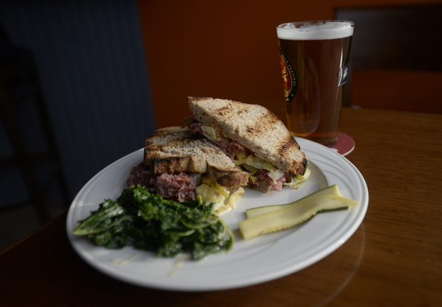 A classic reuben served with a Narragansett beer.