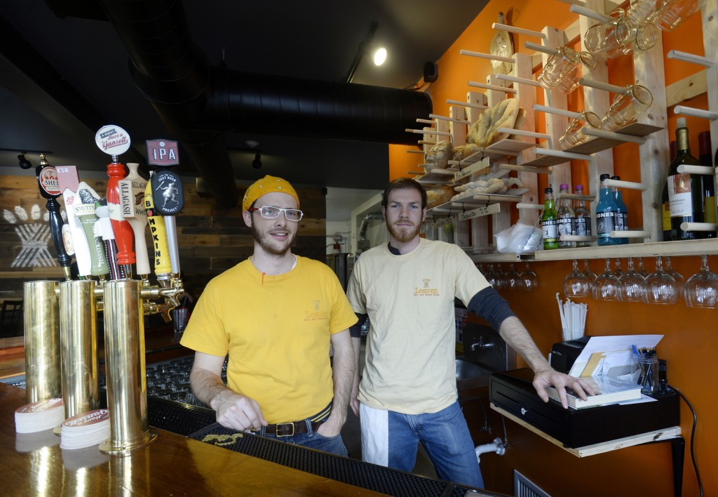 Emmett Soldati, left, and Aidan Watson are two of the three owners of Leaven Beer & Bread House in Somersworth, N.H. Patrick Jackman is the third of the trio that returned from far-flung points and career paths to open Leaven.