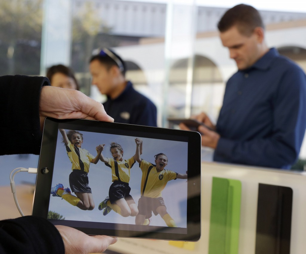The new iPad Air, displayed Friday in Stanford, Calif., is lighter and faster-running and is priced at $499.