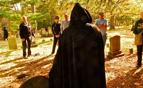 Visitors participate in a recent cemetery walk sponsored by Tate House Museum. The tour featured eight specters from the city's past who talked about life in the 1700s. Among the specters was Mary Tate, the family matriarch.