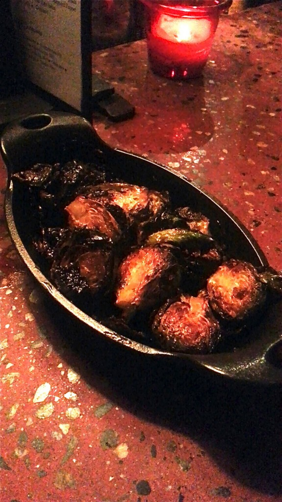 Select appetizers, such as these brussels sprouts, are $3 during happy hour.