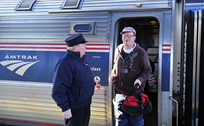 Bryant Witham of Brunswick disembarks Wednesday from the Downeaster in Portland. Witham, a plumber, says he often takes the train to work in Portland because it's fast, punctual and saves money.