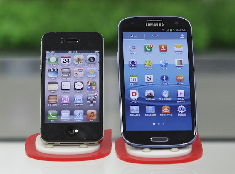 Samsung Electronics' Galaxy S III, right, and Apple's iPhone 4S are displayed at a mobile phone shop in Seoul, South Korea, Friday, Aug. 24, 2012. After a year of scorched-earth litigation, a jury decided Friday, Aug. 24, 2012 that Samsung ripped off the innovative technology used by Apple to create its revolutionary iPhone and iPad.