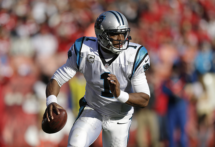 Carolina Panthers quarterback Cam Newton rolls out against the San Francisco 49ers during the third quarter of a game in San Francisco Sunday.