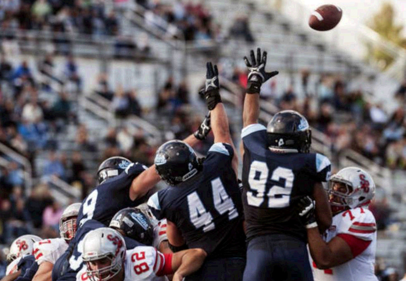 Maine defensive players Michael Cole (9), Patrick Rickard (44) and Trevor Bates (92) attempt to block a Stony Brook field goal in the second half of Saturday's game in Orono.