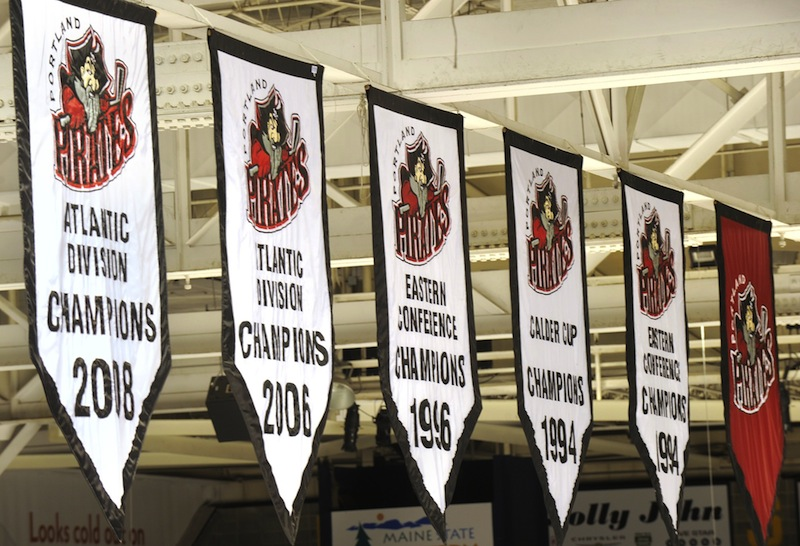 In this March 2010 file photo, the Portland Pirates' championship banners hang from the rafters at the Cumberland County Civic Center. An attempt to get the Civic Center's trustees to resume lease negotiations with the Portland Pirates fell flat recently, so the Portland Community Chamber of Commerce President is trying another tack: replace the trustees.