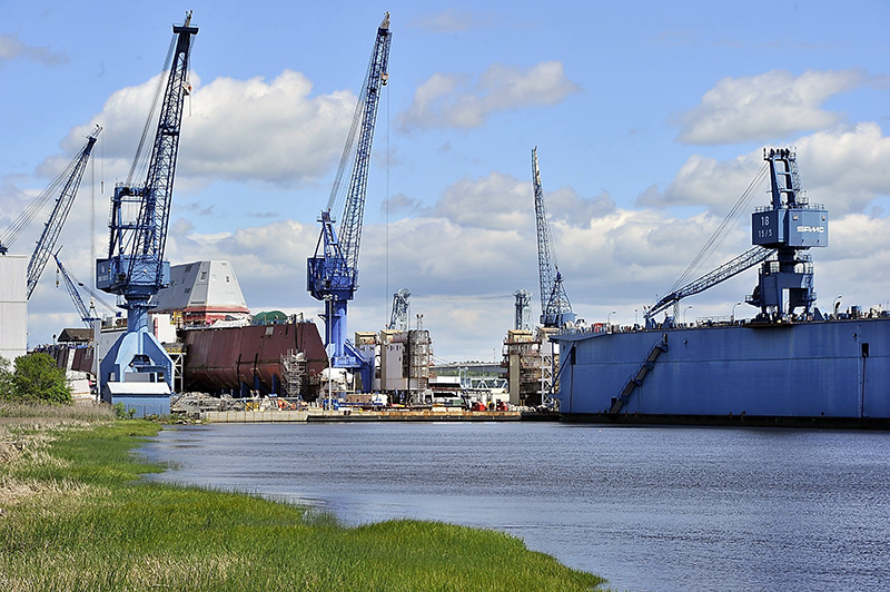 In this June 2013 file photo, the BIW complex of cranes, manufacturing buildings and, right, a dry dock, is seen on the Kennebec River.