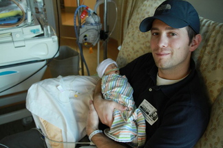 Nick Bowie-Haskell holds his son Charlie in the hospital. Charlie died in December from an incurable cancer, 17 days after he was born.
