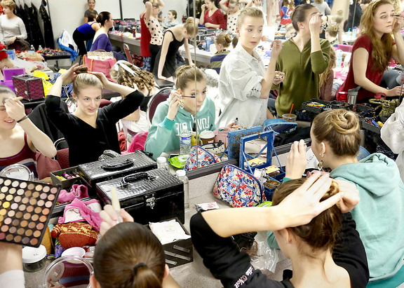 "Dancers do their hair and makeup as they prepare to perform Maine State Ballet's ""The Nutcracker"" at Merrill Auditorium on Sunday afternoon."