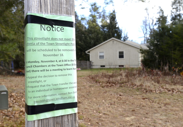 A notice is attached to a streetlight in Windham that is targeted for removal as a cost-cutting measure.