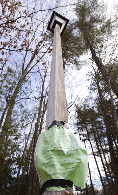 This streetlight in the Timberhill Street subdivision of Windham is one of about 100 targeted for removal as a way to save electricity and cut costs.